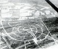 Figure The spiral layout of Ligano Pineta's roads seen from the air prior to construction. School Architecture, Roads, Spiral, Politics, Layout, Construction, Building, Road Routes, Page Layout