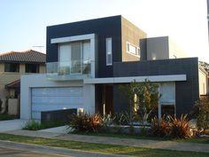 Fachada de casa moderna de dos plantas.