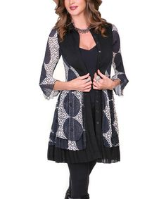 Black & Blue Circle Button-Up Tunic - Women by Lindi A geometric pattern and lightweight construction create an ideal piece for layering. A sheer hem flutters above the knees and the button closure draws the eye up to the face.  Vegan cruelty free made of 100% polyester Cardigan buttons jacket