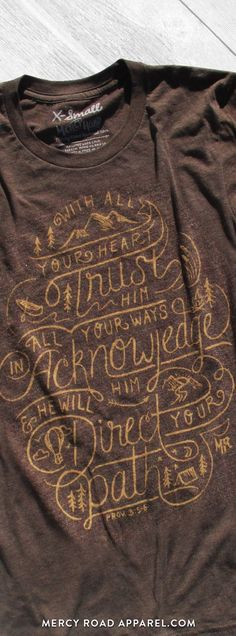 "Christian T-Shirt with adventure theme and Proverbs 3:5-6 ""With all your heart trust Him, in all your ways acknowledge Him, & He will direct your paths."" This scripture shirt is handcrafted and screenprinted on a gloriously comfy chocolate brown triblend tee. Quality Christian clothing for women and men. FREE SHIPPING USA.  Shop >> MercyRoadApparel.com   This design is copyrighted ©2016MercyRoadApparel"