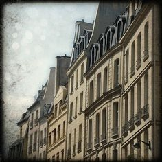 beautiful parisian architecture on rue de buci in the 6th