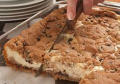 A classic! A favorite! And incredibly delicious! This simple Chocolate Chip Cheesecake is sure to become your standard.    Serves: 15  Cooking Time: 45 min  Ingredients  3 (8-ounce) packages cream cheese, softened  3 eggs  3/4 cup sugar  1 teaspoon vanilla extract  2 (16.5-ounce) rolls refrigerator chocolate chip cookie dough  Instructions  Preheat