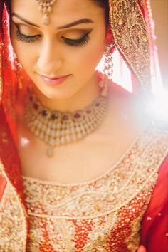 Beautiful Pakistani Bride in Red & Gold | Photo by Dastan Studios