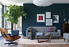 I like the coffee table, throw, and fiddle leaf fig. Also like that this room has a relaxed feel.