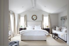 Ashley Goforth Design Upholstered Bed, mercury lamps, bullseye mirror