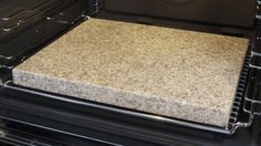 Pizza stone - a scrap piece of Granite counter top.  Indestructible and makes a super crispy crust!