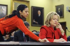 WASHINGTON, DC - MARCH 10: U.S. Secretary of State Hillary Clinton (R) receives a note from her aide Huma Abedin (L) as she testifies about the State Department's FY2012 budget during a hearing of the State, Foreign Operations and Related Programs Subcommittee of the House Appropriations Committee in the Rayburn House Office Building on March 10, 2011 in Washington, DC. Secretary Clinton has recently warned that proposed budget cuts would have a negative effect on U.S. national security…