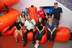 Hector Santiago #53 of the Chicago White Sox poses with the Chicago White Sox Cave Crasher Lisa Loher and her guest Patricia Loher and the MLB Fan Cave Dwellers during a visit to the MLB Fan Cave Wednesday, September 4, 2013, at Broadway and 4th Street in New York City. (Photo by Thomas Levinson/MLB Photos via Getty Images)