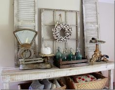 love this fall display with cotton, shutters, seltzer bottles and that scale - swoon