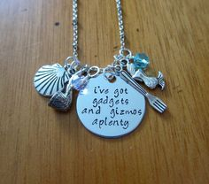 """Ariel Inspired Little Mermaid Necklace. Disney song """"Part Of Your World"""". Hand stamped lyrics """"I've got gadgets and gizmos aplenty"""". Cute Little Mermaid jewelry. Little Mermaid Gift. Swarovski crystals. By WithLoveFromOC"""