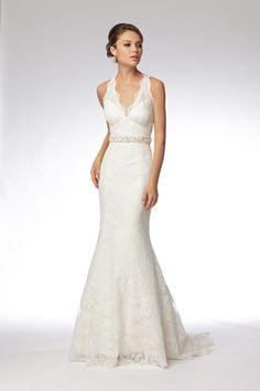 Watters SP 2011 - love this shape  Style:	Lycette  Price:	$1,010  Style Number:	16432  Ivory re-embroidered lace v-neck trumpet gown with keyhole back and pearl and crystal encrusted belt. Sweep train.