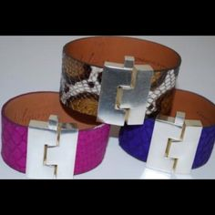 Fuchsia Leighelena Jigsaw Python Buckle Bracelet Each Leighelena piece is handcrafted in Texas. Leighelena offers consumers bold and on-trend items, ideal for those who are interested in fashion, but crave unique, well-designed products. Timeless with a twist, each collection provides the wearer with a little sparkle and a lot of class. Each piece is slightly different and unique, just like those who will wear it!  Styled to fit snugly, fits small to average wrists.   Genuine Python Skin…