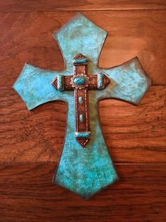 A personal favorite from my Etsy shop https://www.etsy.com/listing/483603857/9-x-12-teal-and-brown-wooden-cross