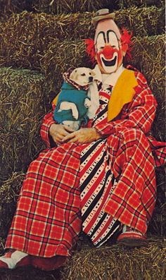 MIRTH MASTER Poor dog looks terrified.   MASTER OF MIRTH — Veteran funnyman, Lou Jacobs, celebrates over a half-century of clown chores with The Greatest Show on Earth.