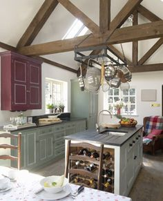 exposed beams with an interesting kitchen configuration...