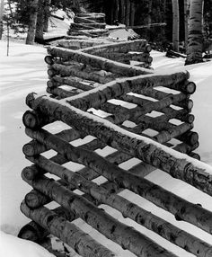 Zig zag log or split-rail fences take more wood, but are also more stable, and require a lot less digging of the fence posts, especially where it's rocky and rugged, like in the mountains.