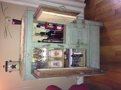My mini bar at home! Got the antique ice box at a garage sale....left it as is....added my booze and bar supplies....instant mini bar :-)