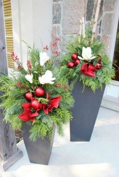 Make the outside of your home as ready for the holiday season as the inside with these outdoor Christmas decorating ideas. Our holiday decorating ideas, including beautiful Christmas greenery, festive light displays, and more, are sure to get your yard Ch Outdoor Christmas Planters, Christmas Urns, Christmas House Lights, Christmas Greenery, Christmas Arrangements, Christmas Flowers, Outdoor Christmas Decorations, Christmas Wreaths, Outdoor Planters