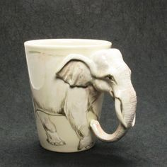 : White Elephant Mug :?: Original hand sculpt and hand paint Elephant Mug This Mug using a durable Stoneware Clay high fired at Degrees Celsius for more durability. Hand Sculpted and Paint Elephant Mugs, Elephant Love, Elephant Art, White Elephant, Elephant Stuff, Funny Elephant, Ceramic Elephant, Elephant Trunk, Stars Disney