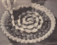 When in a rush, top a cherry pie with a spiral twist. Cut long strips 3/4 inch wide. Then moisten the ends and join the strips together. Twist the long strip and swirl it atop, as above.