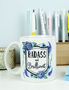 """Be Badass and Brilliant with this fun and vibrantly decorated coffee mug! Ceramic mug holds 11 oz and is UV protected. Microwave and dishwasher safe. All mugs are designed and hand pressed in studio by Kaitlin Goodey of Edmonds, WA. Artist description: A sassy Pacific North Westerner who loves color and fun. This item does not ship from the AlwaysFits.com warehouse. Any additional products ordered with this product will ship separately. This item is not eligible for """"Next Day Shipping""""."""