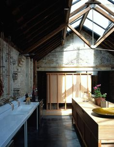 Jonathan Tuckey's home Collage House Interior Kitchen Narrow Cooking island  Ceiling Cenital light Roof Refurbishment