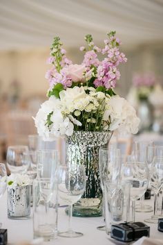 Silver Mercury Glass Vase Centrepieces with Tall White & Pink Flowers | Nigerian Fusion Wedding | Maggie Sottero Geneva Wedding Dress & Cape | Marquee Reception | Silver & Grey Colour Scheme | Images by Jo Hastings Photography | http://www.rockmywedding.co.uk/stephanie-emmanuel/
