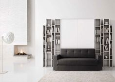 Maximize space in your micro apartment or transform a guest room into a functional space with a wall bed from Mscape. Micro Apartment, Maximize Space, Bed Wall, Sofa, Couch, Modern Interior, Guest Room, Love Seat, Projects To Try