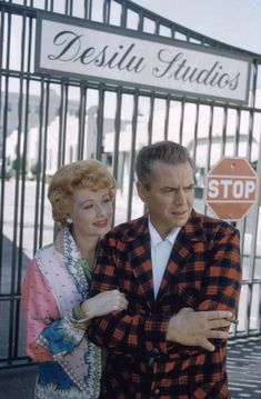 1958: POSING WITH DESI IN FRONT OF THE GATES OF DESILU STUDIOS, THEIR PRODUCTION COMPANY.