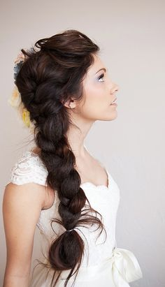 Side Braid Wedding Hairstyle. I Like this look becasue, it kindda fits the look of what we're going for... I'm pretty sure you don't plan on doing it like this though.