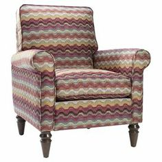 """Roll-arm accent chair with turned legs and a multicolor wave motif. Made in the USA.  Product: ChairConstruction Material: Fabric and woodColor: Raspberry, orange, and minty blueFeatures: Made in the USADimensions: 37.5"""" H x 32"""" W x 32.5"""" DNote: Assembly required"""