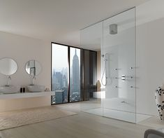 Beautiful city view from an open shower.  I'm thinking this will be even more stunning at night.