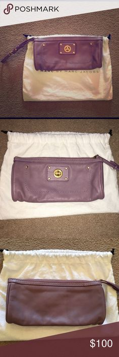 "Marc by Marc Jacobs clutch Marc by Marc Jacobs wristlet/clutch.  Light purple - lilac. 9"" long by 4.5"" tall. No stains or scrapes o the leather or lining. Perfect for a cell phone and makeup. Comes with dust bag. Lock closure on outside is for looks only. Zip close and adjustable wrist strap. Marc by Marc Jacobs Bags Clutches & Wristlets"