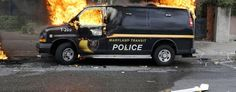 A police vehicle burns during unrest following the funeral of Freddie Gray in Baltimore. (Patrick Semansky/AP)