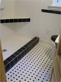 Our bathroom floor. Possibly use solid black tiles to replace if needed during remodel?