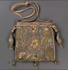English, late century England Dimensions Overall (without tassels and cord): 13 x 13 cm x 5 in.) Medium or Technique Linen plain weave embroidered with silk, silver and gold metallic threads Braided silk and metallic cords and tassels Vintage Purses, Vintage Bags, Vintage Handbags, Tent Stitch, Potli Bags, Renaissance, Sweet Bags, Celtic, Embroidered Bag