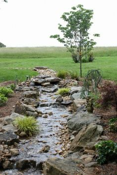 Natural water feature to cover up a regular creek | Green Turf Irrigation | www.greenturf.com/services