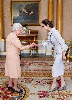 Celebrity guest: Actress Angelina Jolie is pictured being presented with the Insignia of an Honorary Dame Commander of the Most Distinguished Order of St Michael and St George by Queen Elizabeth II in the 1844 Room at Buckingham Palace on October 2014 Princesa Kate, Jolie Pitt, Le Jolie, Angelina Jolie Style, Angelina Joile, Angelina Jolie Wedding, Ralph & Russo, Estilo Real, Queen Of England