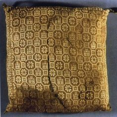 The other side of the knitted cushion from the tomb of the infante Fernando de la Cerda c.1275, in the Abbey of Santa María la Real de Las Huelgas, outside of Burgos, Spain. Probably originally red and yellow. Most likely made by Mudéjar craftsmen. A Mudéjar is a Muslim of Al-Andalus who remained in Iberia after the Reconquista but did not convert to Christianity, unlike Moriscos who had converted.