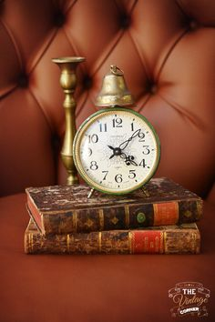 vintage clock on old books