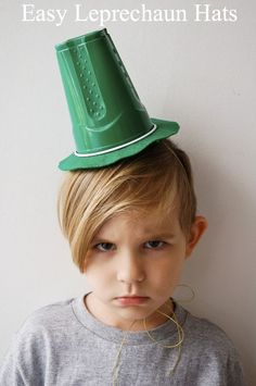 New use for a plastic solo cup! Make the Leprechaun Hats for St. Patrick's Day using a simple plastic cup! I promise he likes it more than his face says...