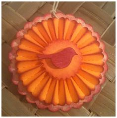 FOUR Paper Rosettes Tangerine Raspberry Diecut Wooden Birds Layered Scalloped Circle Handmade All Occasion Gift Tags. $4.75, via Etsy.