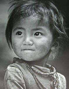 Little Chinese girl, eyes tell a story./ BIBLE IN MY LANGUAGE