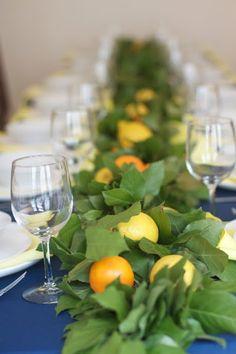 Lemon and orange garland as table runner/centerpiece for long table.