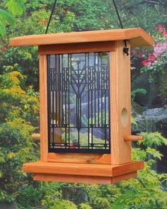 The Frank Lloyd Wright Darwin D. Martin House Bird Feeder has insert designs adapted from a Tree of Life art glass window sketch study for the Martin House, loc