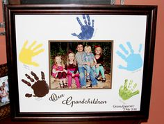"""Grandparents Gift 2011... I purchased an autograph framed mat from Michaels on sale for $20 and got all the grandkids together to get their handprints and a picture.  I used my cricut to cut out vinyl letters for the """"Our Grandchildren"""" and """"Grandparents Day 2011"""" This turned out super cute :)"""