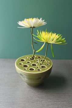 Lotus pod vase by potteryandtile on Etsy. I bought this and just love it!