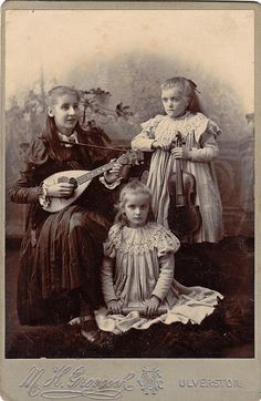 Girls with musical instruments. Ulverston, Cumbria. by benicektoo, via Flickr