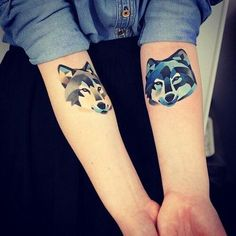 Beautiful wolf watercolor tattoo on arm for girls