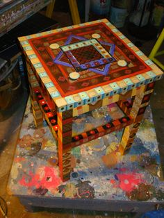 During the busy last few weeks, I also painted this small wooden stool. In the backround you can see the ver beginning of the Fruit Floorclo...
